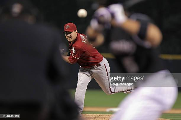 Starting pitcher Joe Saunders of the Arizona Diamondbacks delivers against Carlos Gonzalez of the Colorado Rockies at Coors Field on September 7,...