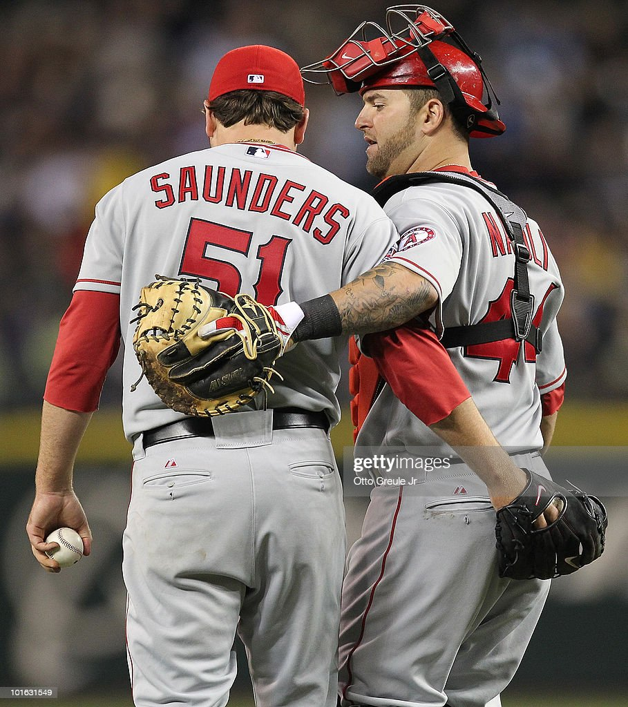 Starting pitcher Joe Saunders #51 of the Los Angeles Angels of Anaheim gets a visit from catcher Mike Napoli #44 during action against the Seattle Mariners at Safeco Field on June 4, 2010 in Seattle, Washington.