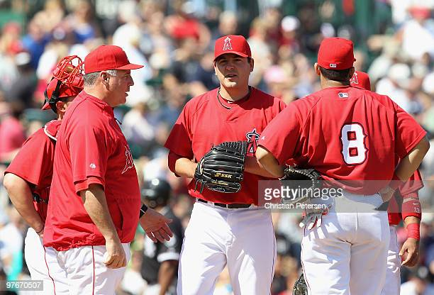 Starting pitcher Joe Saunders of the Los Angeles Angels of Anaheim is removed by manager Mike Scioscia during the second inning of the MLB spring...