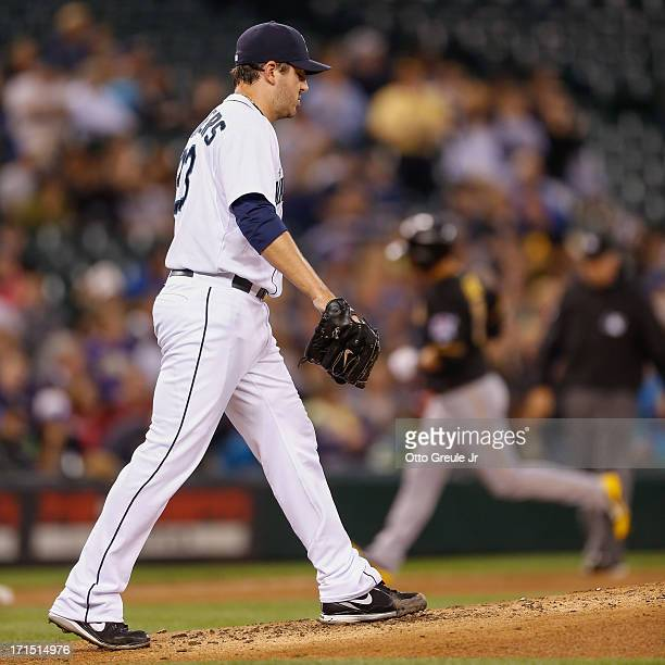 Starting pitcher Joe Saunders of the Seattle Mariners gets back on the mound after giving up a threerun home run to Brandon Inge of the Pittsburgh...