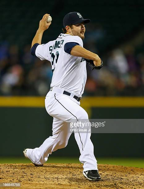 Starting pitcher Joe Saunders of the Seattle Mariners pitches against the Texas Rangers at Safeco Field on April 13 2013 in Seattle Washington