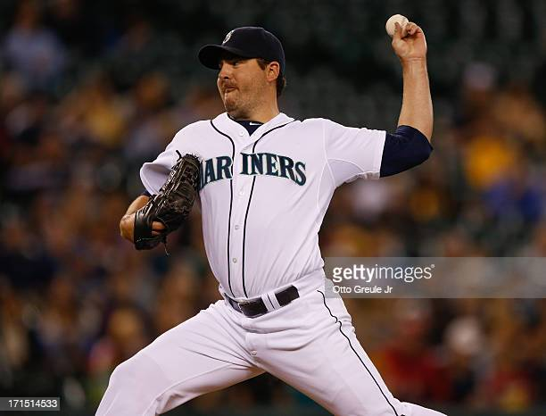 Starting pitcher Joe Saunders of the Seattle Mariners pitches against the Pittsburgh Pirates at Safeco Field on June 25 2013 in Seattle Washington