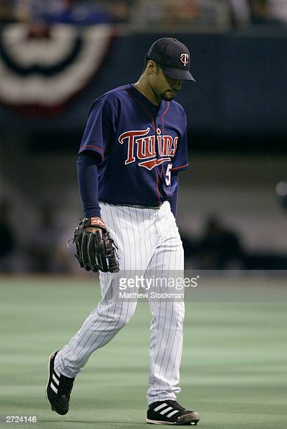 Starting pitcher Johan Santana of the Minnesota Twins walks off the field against the New York Yankees after the first inning of game four of the...
