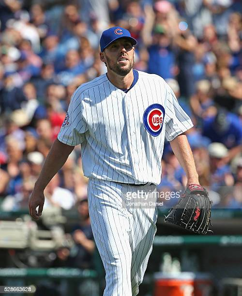 Starting pitcher John Lackey of the Chicago Cubs leaves the field after finishing the 7th inning against the Washington Nationals at Wrigley Field on...