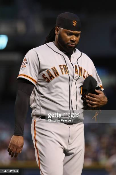 Starting pitcher Johnny Cueto of the San Francisco Giants walks to the dugout after pitching against the Arizona Diamondbacks during the first inning...