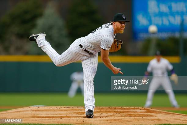 Starting pitcher Jon Gray of the Colorado Rockies delivers to home plate during the first inning against the Los Angeles Dodgers at Coors Field on...