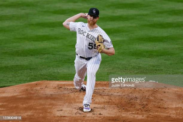 Starting pitcher Jon Gray of the Colorado Rockies delivers to home plate during the first inning against the San Francisco Giants at Coors Field on...