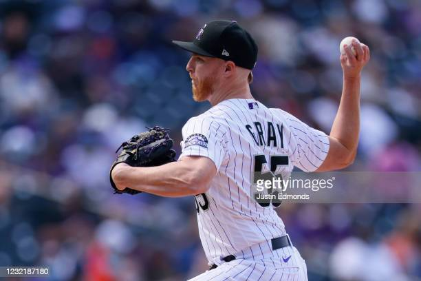 Starting pitcher Jon Gray of the Colorado Rockies delivers to home plate during the seventh inning against the Arizona Diamondbacks at Coors Field on...