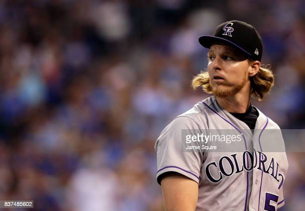 Starting pitcher Jon Gray of the Colorado Rockies looks back as he walks off the field after the 3rd inning of the game against the Kansas City...