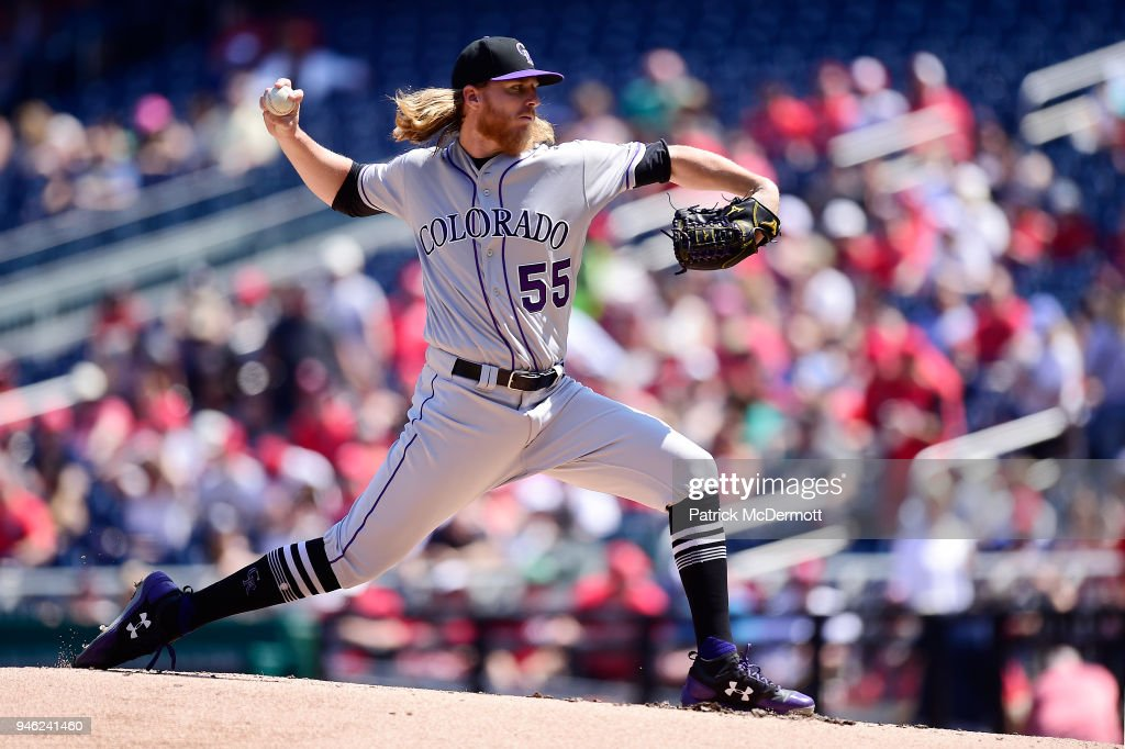 Starting pitcher Jon Gray #55 of the Colorado Rockies throws a pitch against the Washington Nationals in the first inning at Nationals Park on April 14, 2018 in Washington, DC.