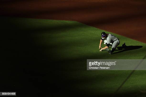 Starting pitcher Jon Gray of the Colorado Rockies warms up before the start of the National League Wild Card game against the Arizona Diamondbacks at...