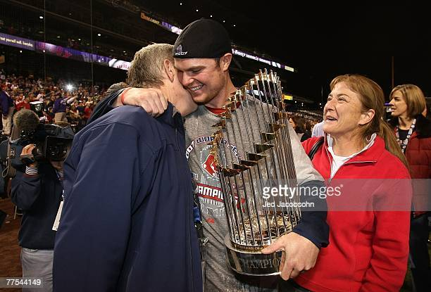 Starting pitcher Jon Lester of the Boston Red Sox celebrates with his parents after winning Game Four by a score of 43 to win the 2007 Major League...