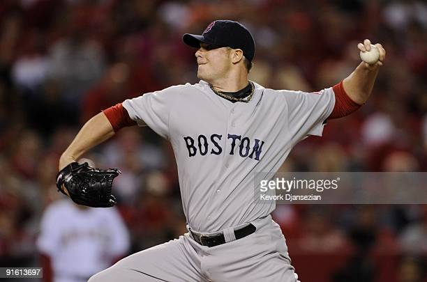 Starting pitcher Jon Lester of the Boston Red Sox delivers a pitch in the first inning of Game One of the ALDS against the Los Angeles Angels of...