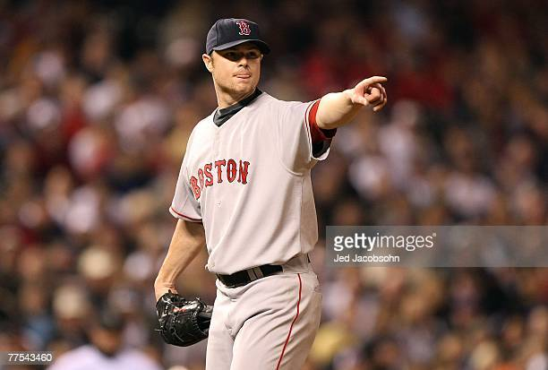 Starting pitcher Jon Lester of the Boston Red Sox points to first base during Game Four of the 2007 Major League Baseball World Series against the...