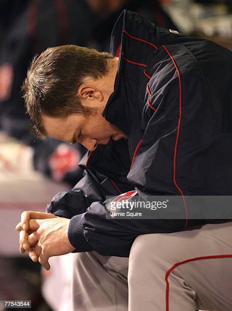 Starting pitcher Jon Lester of the Boston Red Sox sits in the dugout after being pulled during Game Four of the 2007 Major League Baseball World...