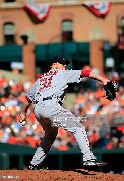 Starting pitcher Jon Lester of the Boston Red Sox throws a pitch to a Baltimore Orioles batter during the second inning of Opening Day at Oriole Park...