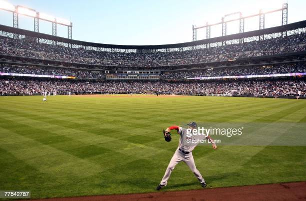 Starting pitcher Jon Lester of the Boston Red Sox warms up in the outfield before Game Four of the 2007 Major League Baseball World Series against...