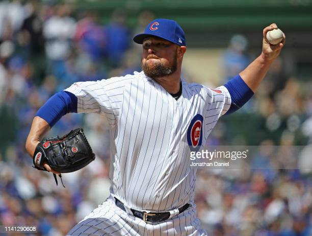Starting pitcher Jon Lester of the Chicago Cubs delivers the ball against the Pittsburgh Pirates during the home opening game at Wrigley Field on...