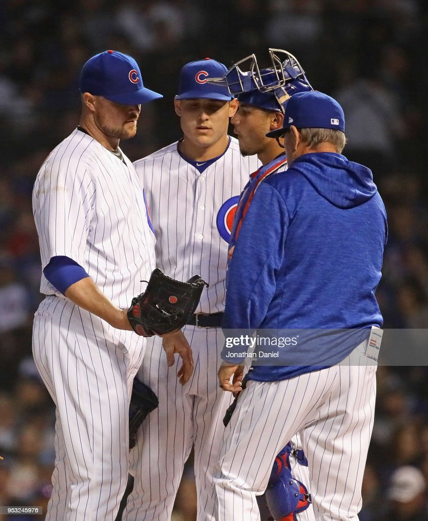 Starting pitcher Jon Lester #34 of the Chicago Cubs is taken out of the game against the Colorado Rockies by manager Joe Maddon #70 in the 6th inning at Wrigley Field on April 30, 2018 in Chicago, Illinois.