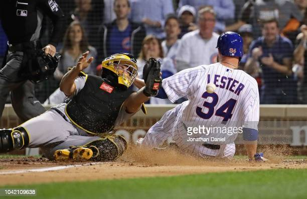 Starting pitcher Jon Lester of the Chicago Cubs slides in to score a run as Francisco Cervelli of the Pittsburgh Pirates misses the relay throw in...