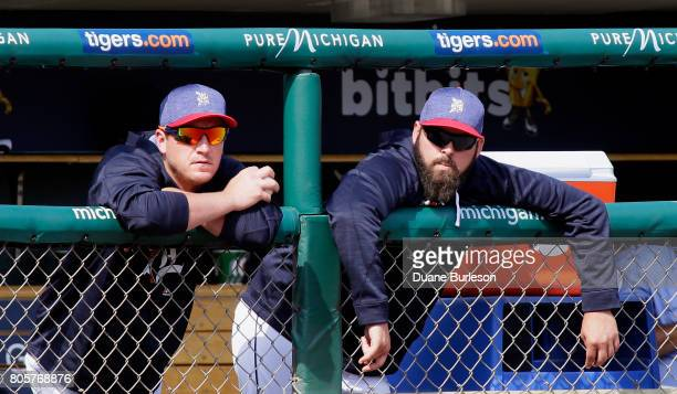 Starting pitcher Jordan Zimmermann of the Detroit Tigers and Michael Fulmer of the Detroit Tigers watch from the dugout during the ninth inning of...