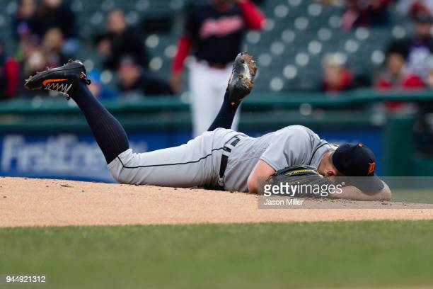 Starting pitcher Jordan Zimmermann of the Detroit Tigers lies on the ground after being hit in the head by a line drive hit by Jason Kipnis of the...