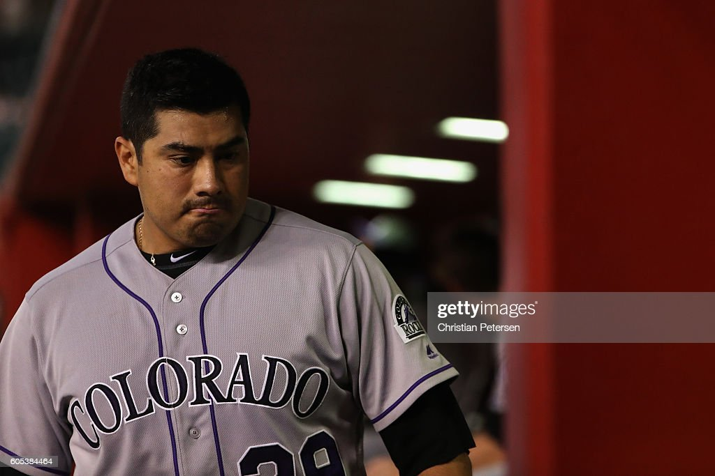 Starting pitcher Jorge De La Rosa #29 of the Colorado Rockies walks in the dugout after being removed during the fourth inning of the MLB game against the Arizona Diamondbacks at Chase Field on September 13, 2016 in Phoenix, Arizona.