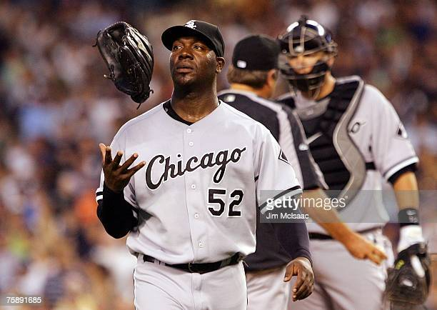 Starting pitcher Jose Contreras of the Chicago White Sox tosses his glove as he leaves the game against the New York Yankees in the third inning on...