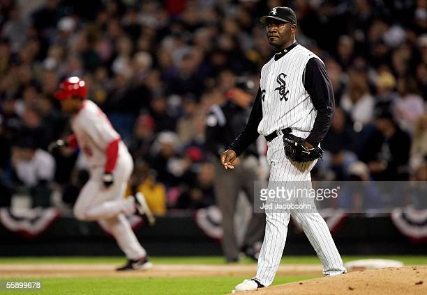 Starting pitcher, Jose Contreras of the Chicago White Sox walks back to the mound as Garret Anderson of the Los Angeles Angels of Anaheim rounds the...