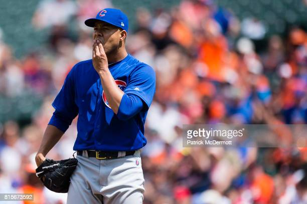 Starting pitcher Jose Quintana of the Chicago Cubs reacts after Adam Jones of the Baltimore Orioles hit a ground rule double to left in the fourth...