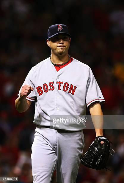 Starting pitcher Josh Beckett of the Boston Red Sox celebrates after closing the eighth inning against the Cleveland Indians during Game Five of the...