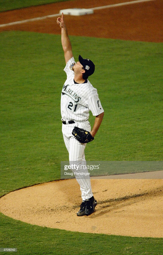 Starting pitcher Josh Beckett #21 of the Florida Marlins locates a pop fly in the air during game three of the Major League Baseball World Series against the New York Yankees on October 21, 2003 at Pro Player Stadium in Miami, Florida. The Yankees defeated the Marlins 6-1.