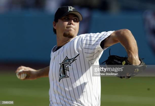 Starting pitcher Josh Beckett of the Florida Marlins pitches against the Chicago Cubs in game five of the National League Championship Series on...