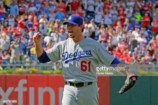 Starting pitcher Josh Beckett of the Los Angeles Dodgers celebrates in the ninth inning after recording a no hitter during a game against the...