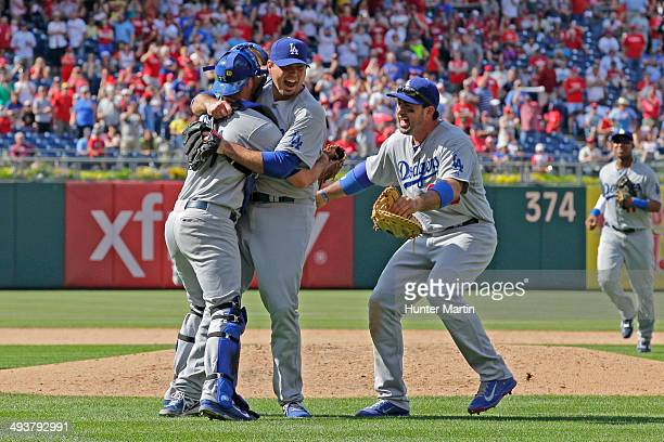 Starting pitcher Josh Beckett of the Los Angeles Dodgers celebrates with teammates after throwing a no hitter against the Philadelphia Phillies at...