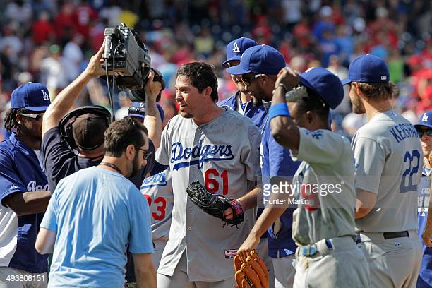 Starting pitcher Josh Beckett of the Los Angeles Dodgers celebrates with teammates after throwing a no hitter during a game against the Philadelphia...