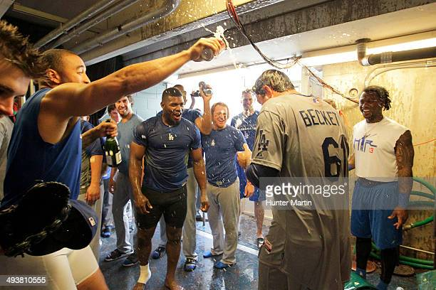 Starting pitcher Josh Beckett of the Los Angeles Dodgers is sprayed by teammates outside of the clubhouse after throwing a no-hitter against the...