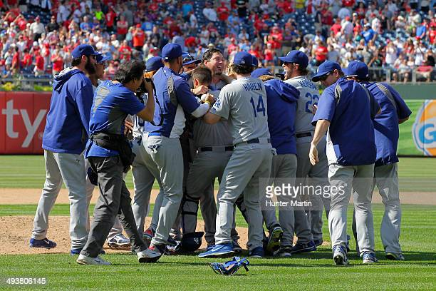 Starting pitcher Josh Beckett of the Los Angeles Dodgers is swarmed by teammates after throwing a no hitter against the Philadelphia Phillies at...