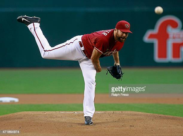 Starting pitcher Josh Collmenter of the Arizona Diamondbacks delivers a pitch against the Colorado Rockies during the first inning of a MLB game at...
