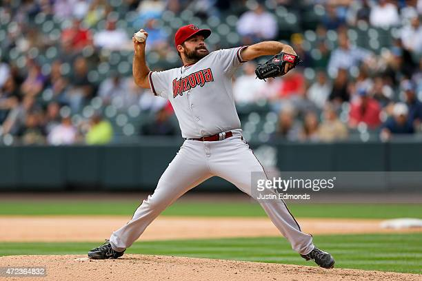 Starting pitcher Josh Collmenter of the Arizona Diamondbacks delivers to home plate during the third inning against the Colorado Rockies at Coors...