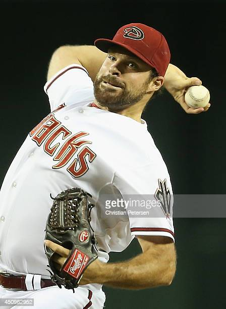 Starting pitcher Josh Collmenter of the Arizona Diamondbacks pitches against the San Francisco Giants during the MLB game at Chase Field on June 20...