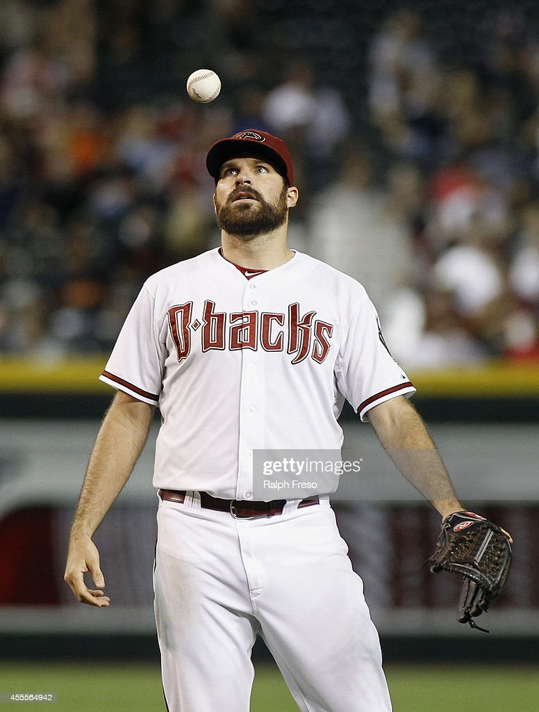Starting pitcher Josh Collmenter #55 of the Arizona Diamondbacks reacts by tossing the ball in the air after giving up a hit to Hunter Pence #8 of the San Francisco Giants during the seventh inning of a MLB game at Chase Field on September 16, 2014 in Phoenix, Arizona.