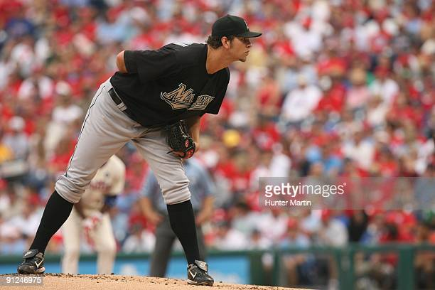 Starting pitcher Josh Johnson of the Florida Marlins gets ready to deliver a pitch during a game against the Philadelphia Phillies at Citizens Bank...