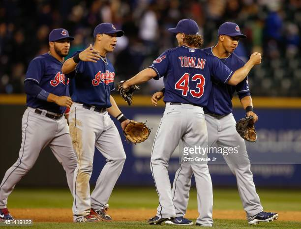 Starting pitcher Josh Tomlin of the Cleveland Indians celebrate with teammates after throwing a complete game 50 shutout against the Seattle Mariners...