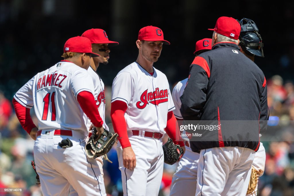 Starting pitcher Josh Tomlin #43 of the Cleveland Indians listens to pitching coach pitching coach Carl Willis #51 during the sixth inning against the Seattle Mariners at Progressive Field on April 29, 2018 in Cleveland, Ohio.