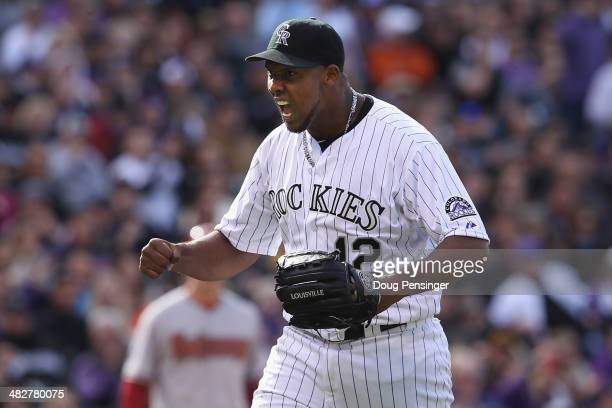 Starting pitcher Juan Nicasio of the Colorado Rockies reacts to a defensive play by second baseman DJ LeMahieu of the Colorado Rockies to end the top...