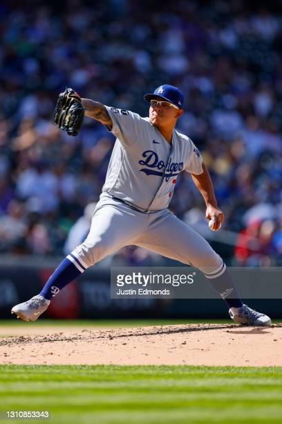 Starting pitcher Julio Urias of the Los Angeles Dodgers delivers to home plate during the sixth inning against the Colorado Rockies at Coors Field on...