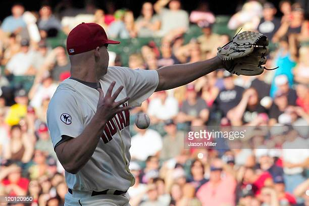 Starting pitcher Justin Masterson of the Cleveland Indians bobbles a pop fly during the second inning against the Kansas City Royals at Progressive...
