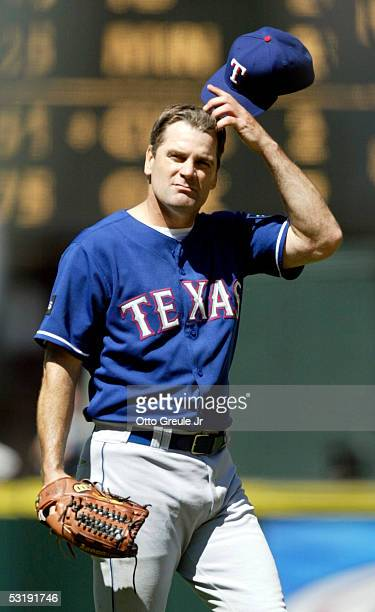 Starting pitcher Kenny Rogers of the Texas Rangers reacts after giving up a run in the 8th inning against the Seattle Mariners on July 3 2005 at...
