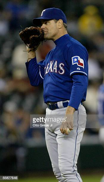 Starting Pitcher Kenny Rogers of the Texas Rangers reacts after giving up an RBI single to Richie Sexson of the Seattle Mariners which tied the game...